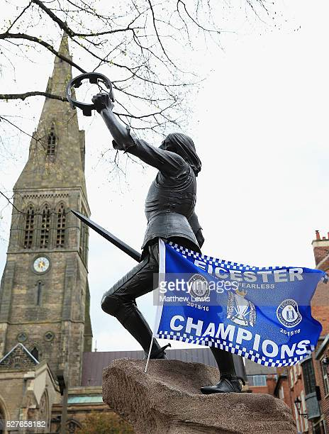 A statue of King Richard III is seen with a Leicester City FC flag as Leicester reacts to Leicester City's Premier League Title Success on May 03...
