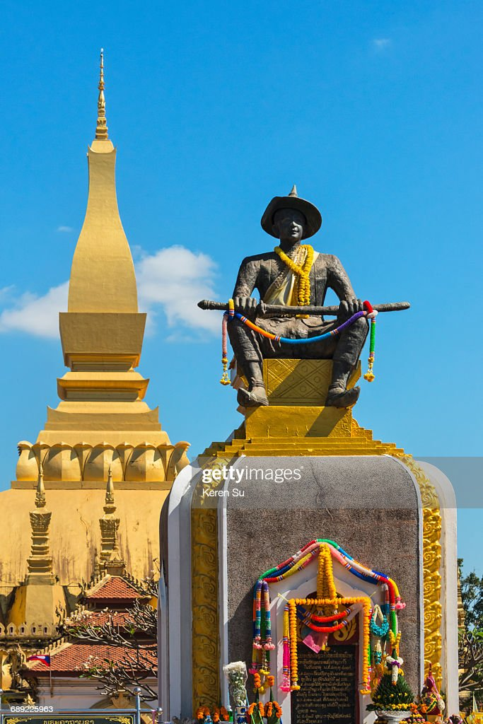 Statue of King Setthathirat with Pha That Luang : Stock Photo