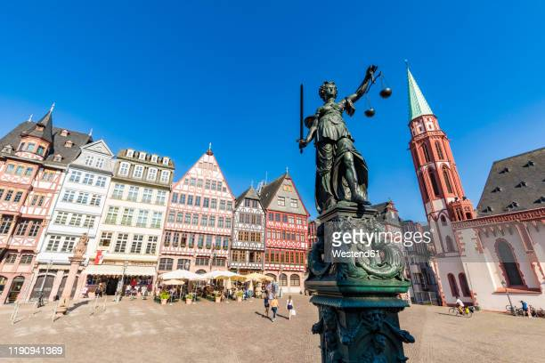 statue of lady justice at rmerberg old town square against clear sky in frankfurt, germany - st. nicholas cathedral stock pictures, royalty-free photos & images
