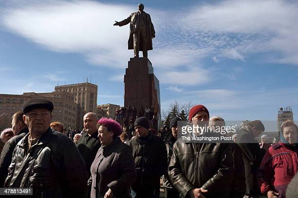 A statue of Lenin looms over a crowd as supporters of the local Mayor of Kharkiv Hennadiy Kernes gathered in Independence Square in Kharkiv Ukraine...