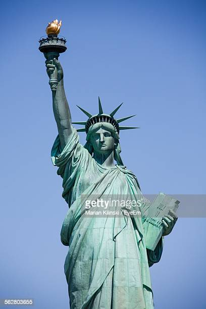 statue of liberty against clear blue sky - statue of liberty stock pictures, royalty-free photos & images