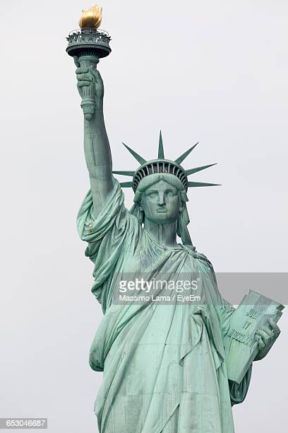 statue of liberty against clear sky - statue of liberty stock pictures, royalty-free photos & images