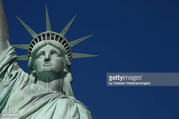 statue of liberty against deep blue sky - statue of liberty stock pictures, royalty-free photos & images