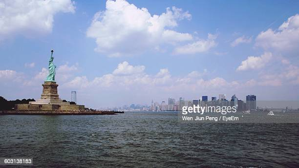 Statue Of Liberty Against Sky With Waterfront