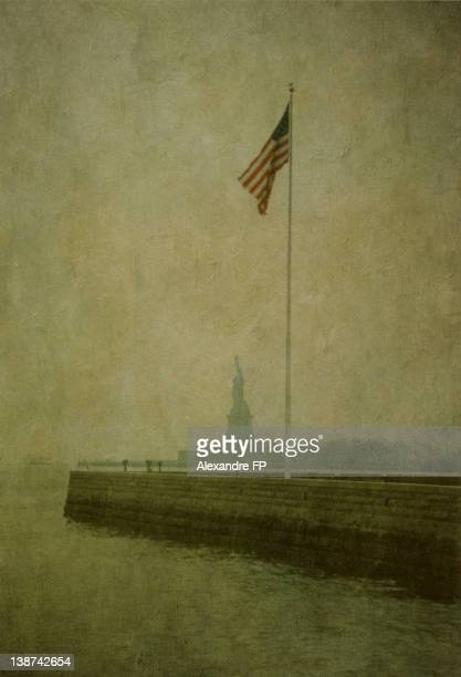 Statue of Liberty and American Flag on flagpole