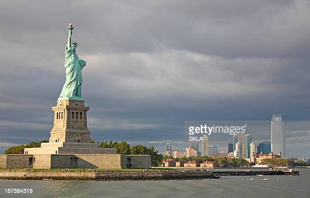 Statue of Liberty (foreground) and Manhattan (background). New York, USA