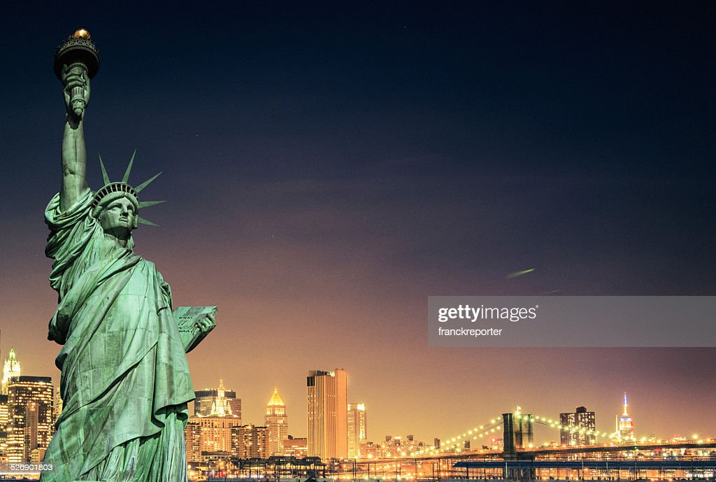 Statue of Liberty and New York City skyline : Stock Photo