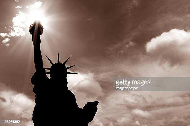 statue of liberty and sun beam