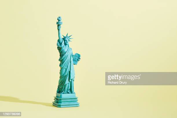 a statue of liberty figurine - freedom stock pictures, royalty-free photos & images