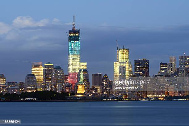 CONTENT] Statue of Liberty Hudson River Liberty Island New York Downtown Manhattan One World Trade Center 1 WTC Freedom Tower cityscape skyline night...