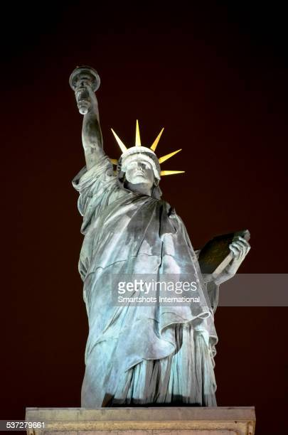 Statue of Liberty illuminated at night, Paris