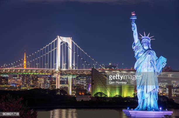 Statue of Liberty in Odaiba area, Rainbow bridge and Tokyo Tower landmark, Tokyo, Japan