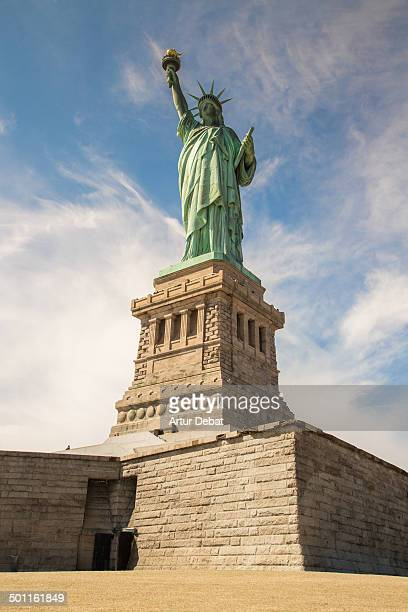 """Statue of Liberty"""" sculture high view below architecture building construction island visiting """"New York"""" USA US America sky sunny"""
