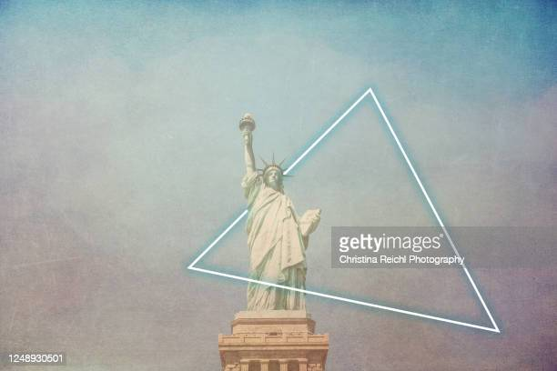 statue of liberty with a neon sign - new york harbour stock pictures, royalty-free photos & images