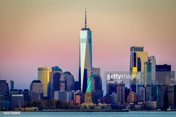 statue of liberty with manhattan in the background - new york harbour stock pictures, royalty-free photos & images
