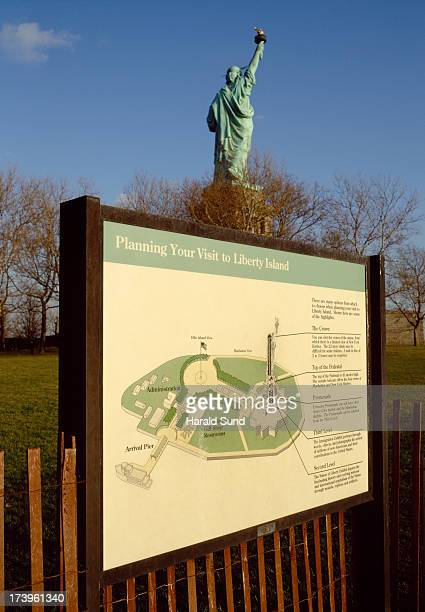 Statue of Liberty with map of Liberty Island
