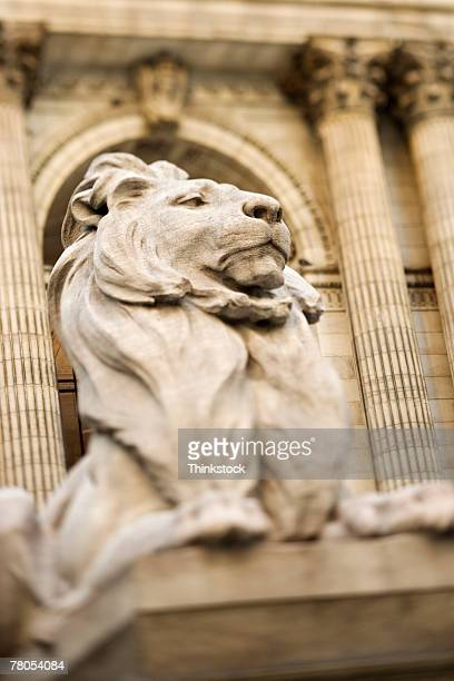 statue of lion outside new york public library, new york city, ny - new york public library stock pictures, royalty-free photos & images