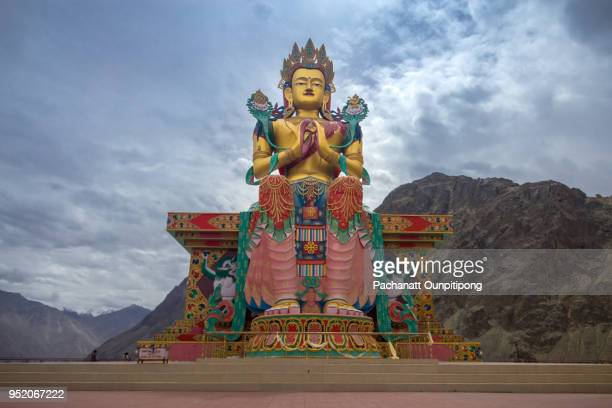 statue of maitreya buddha near diskit monastery, ladakh, india - bodhisattva stock pictures, royalty-free photos & images