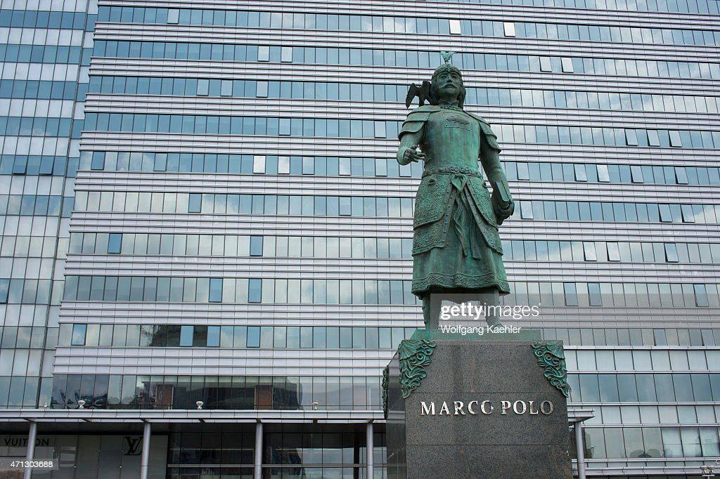 Statue of Marco Polo in front of Central Tower in downtown ...