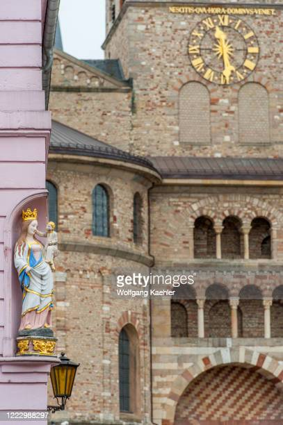 Statue of Maria and Christ on the corner of a house on the market square in Trier, Germany.
