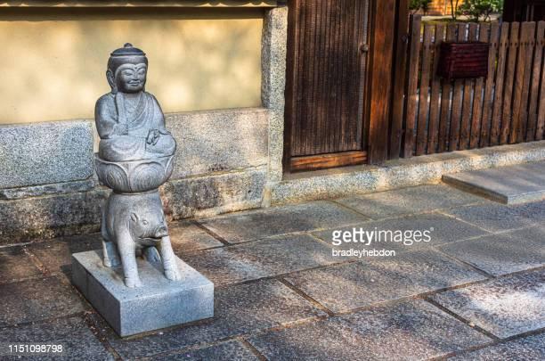 statue of marici riding a boar, on streets of kyoto, japan - buddhist goddess imagens e fotografias de stock