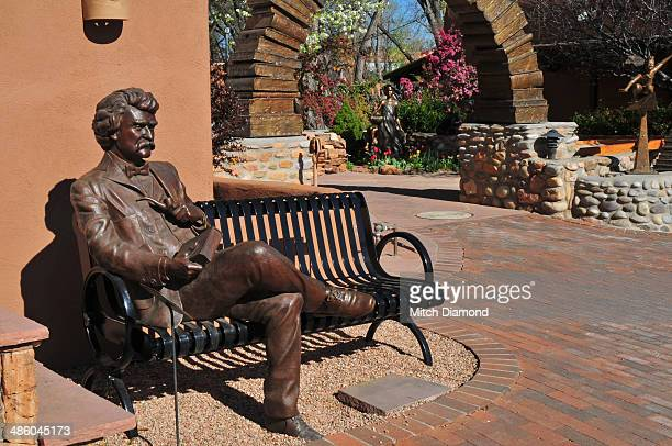 statue of mark twain sitting on a bench - mark twain stock photos and pictures