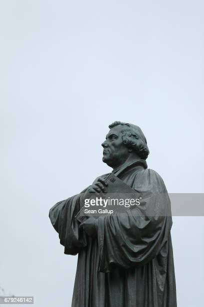 A statue of Martin Luther whose 95 theses of 1517 set in motion the Reformation stands in the city center on May 5 2017 in Eisenach Germany Luther...