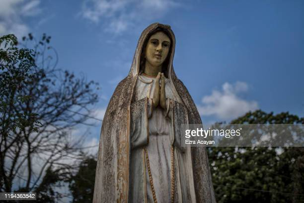A statue of Mother Mary is seen covered in volcanic ash from Taal Volcano's eruption on January 18 2020 in Tanauan Batangas province Philippines The...