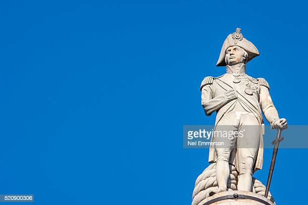 statue of nelson in trafalgar square, london, uk - nelson's column stock photos and pictures