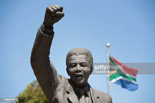 A statue of Nelson Mandela an antiapartheid revolutionary and the former president of South Africa depicting him walking to freedom with a South...