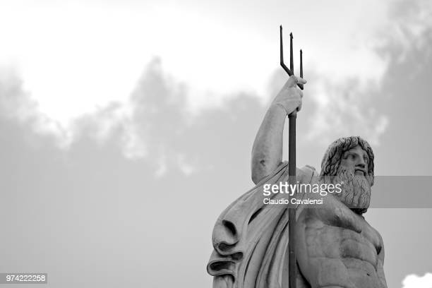 statue of neptune against sky, rome, italy - neptune roman god stock pictures, royalty-free photos & images