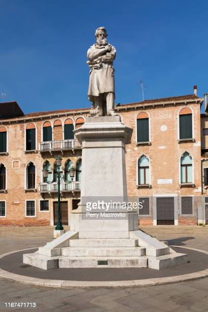 statue of nicolo tommaseo in campo santo stefano square - nicolo campo stock pictures, royalty-free photos & images