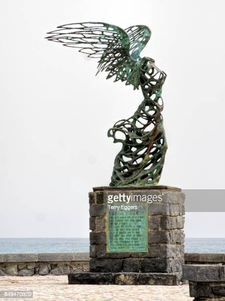 Statue of Nike, goddess of victory by sculptor Carmelo Mendola near the sea.