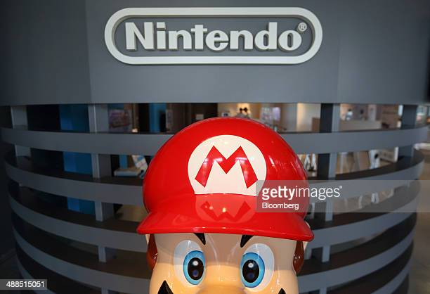 A statue of Nintendo Co's videogame character Mario stands at the company's showroom in Tokyo Japan on Wednesday May 7 2014 Nintendo the world's...