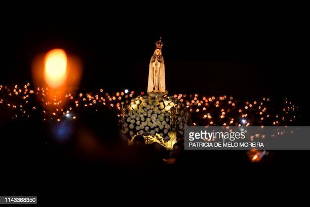 A statue of Our Lady Fatima is carried during the candle procession at the Fatima shrine in Fatima central Portugal on May 12 2019 Thousands of...