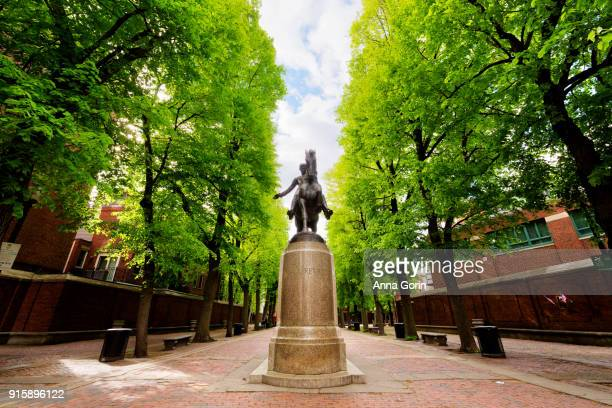 statue of paul revere on horse in center of paul revere mall leading to old north church along freedom trail, spring afternoon, boston massachusetts - boston stock pictures, royalty-free photos & images