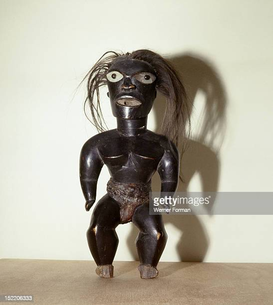 Statue of Pele the Hawaiian fire goddess a malign force who lives in the crater of Kilauea volcano Hawaii Polynesia 17th 18th c