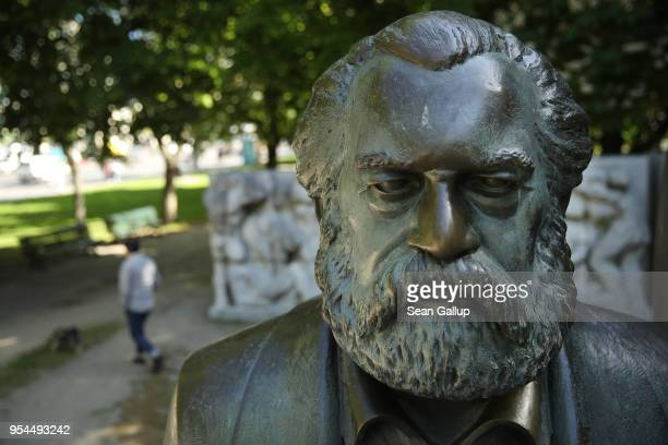 A statue of philosopher and revolutionary Karl Marx stands in a public park on May 4 2018 in Berlin Germany The German city of Trier Marx's...
