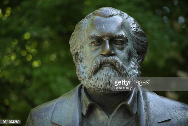 Statue of philosopher and revolutionary Karl Marx stands in a public park on May 4, 2018 in Berlin, Germany. The German city of Trier, Marx's...