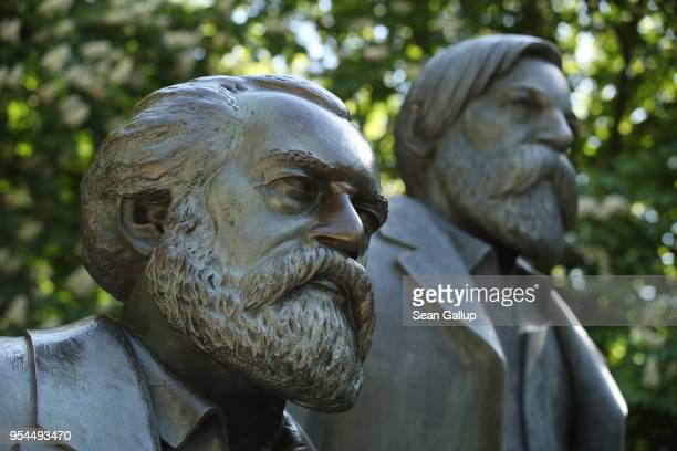 Statue of philosophers Karl Marx and Friedrich Engels stands in a public park on May 4, 2018 in Berlin, Germany. The German city of Trier, Marx's...