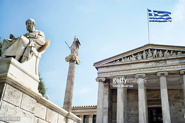 A statue of Plato statue of Godes Athina and Greek flag are seen in front of the Athens Academy building on June 3 in Athens Greece Greek Prime...