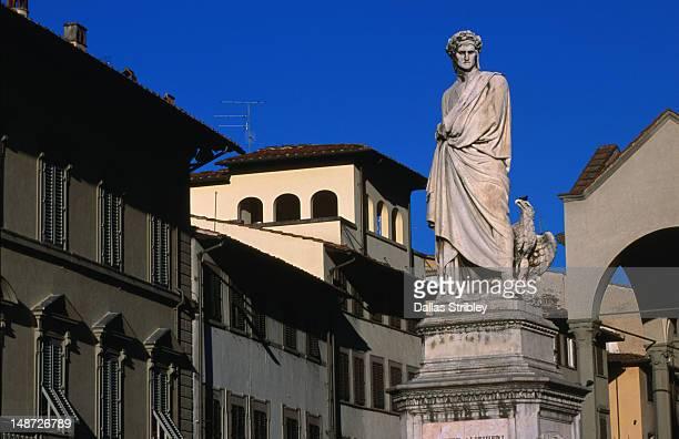 statue of poet dante alighieri in the piazza di santa croce in florence. - firenze foto e immagini stock