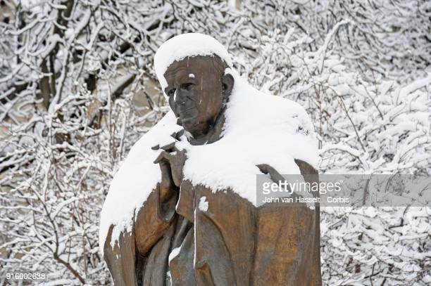 Statue of Pope Saint JeanPaul II next to the Notre Dame Cathedral on February 07 2018 in Paris France After a steady snowfall the French capital...