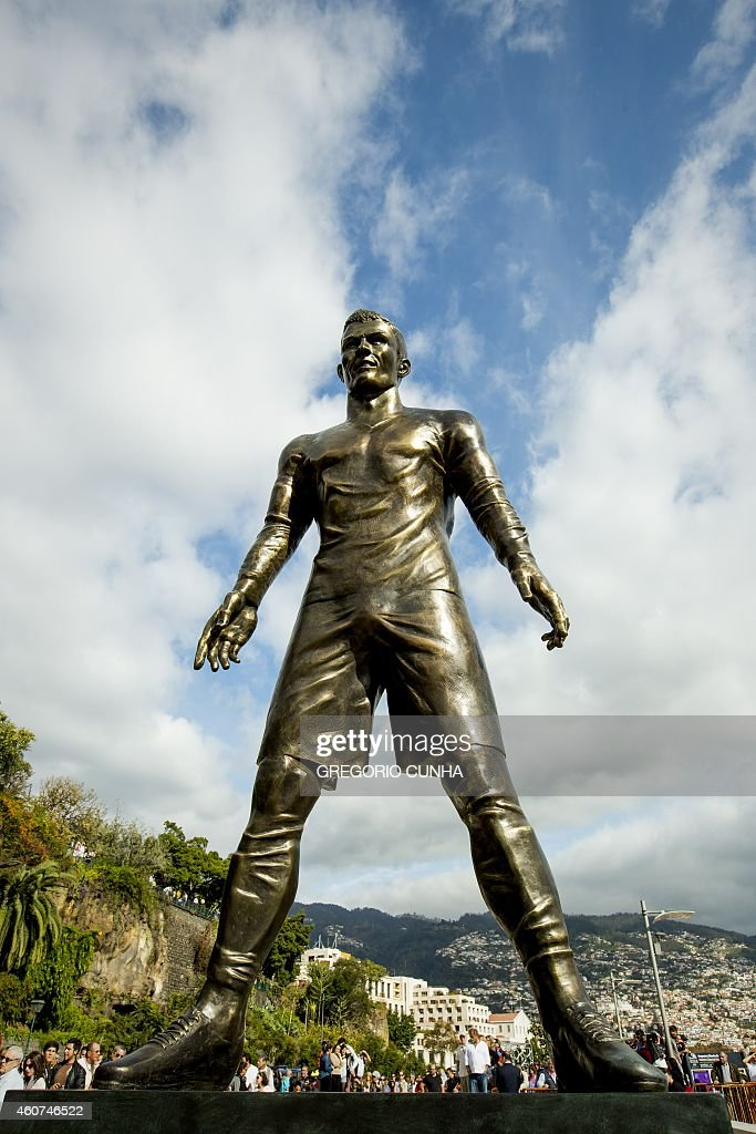 A statue of Portuguese national team football player Cristiano Ronaldo and Real Madrid player is pictured during the unveling ceremony in his hometown in Funchal on December 21, 2014.