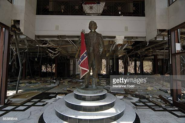 A statue of President Jefferson Davis is seen with the Confederate flag that came to rest in the statues hand having been blown there by the winds of...