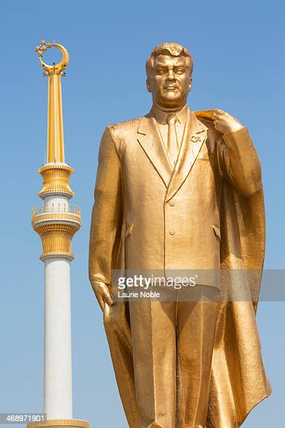 statue of president niyazov, independence monument - ashgabat stock pictures, royalty-free photos & images