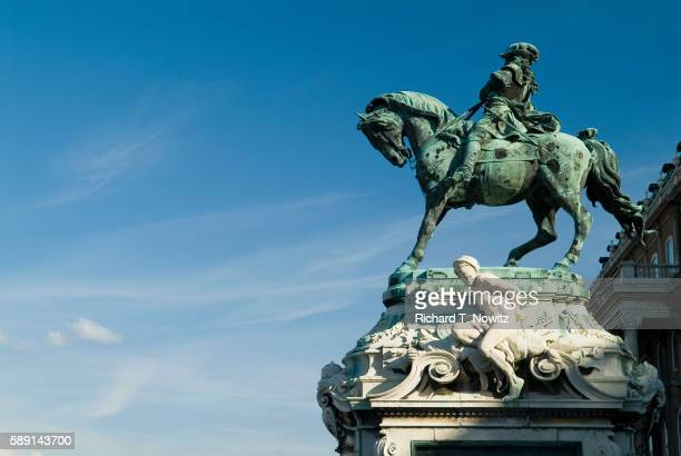 statue of prince eugene outside royal palace in budapest - traditionally hungarian stockfoto's en -beelden