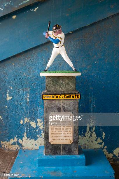 A statue of Puerto Rican baseball player Roberto Clemente who played 18 seasons in Major League Baseball for the Pittsburgh Pirates and was the first...