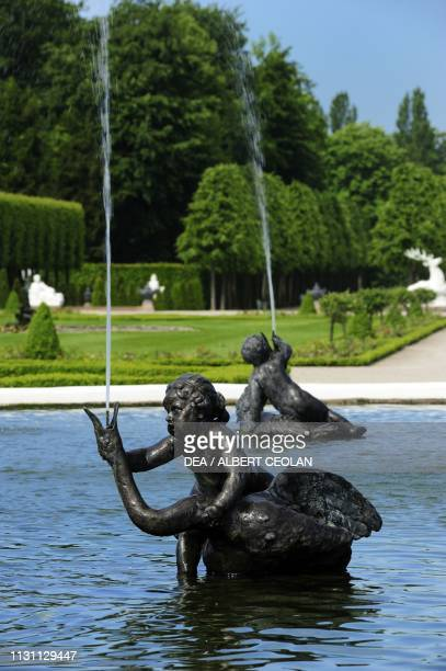 Statue of putto with swan fountain in the garden of Schwetzingen Castle BadenWurttemberg Germany