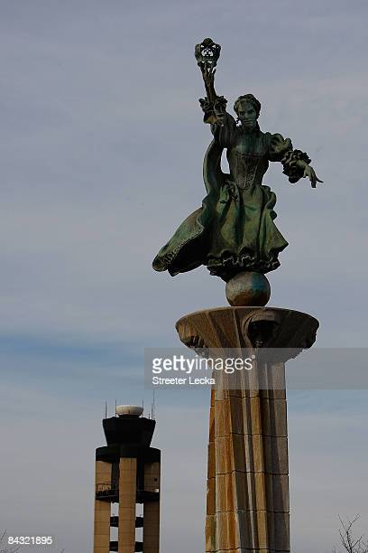 A statue of Queen Charlotte of MecklenburgStrelitz sits in front of the air control tower at CharlotteDouglas International Airport on January 16...